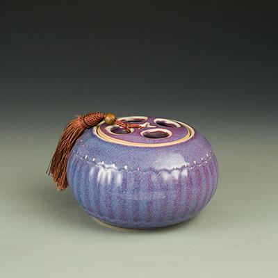 茶叶罐-垕彩实业镂空盖茶叶罐