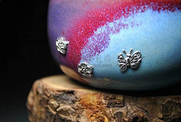 锔瓷-钧瓷茶杯-锔银工艺:锯瓷放大效果图,蝴蝶和花瓣
